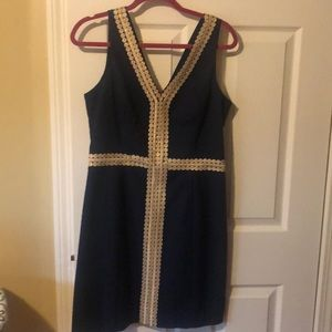 Lilly Pulitzer navy shift dress with gold accents.